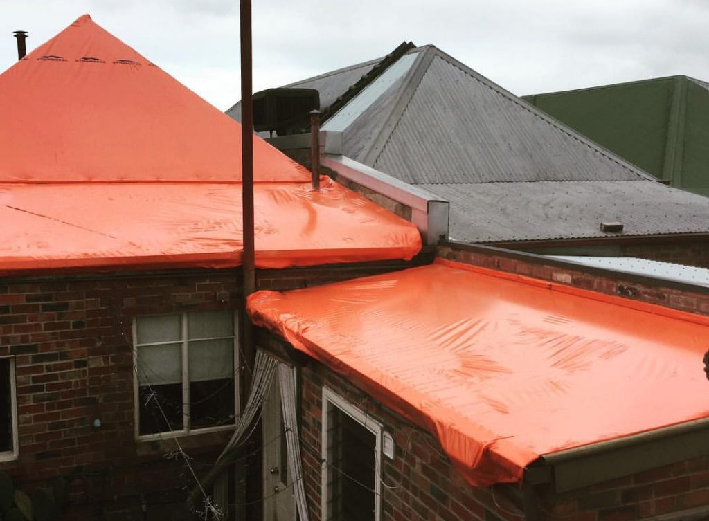 Next Level Restoration Roof wrapping